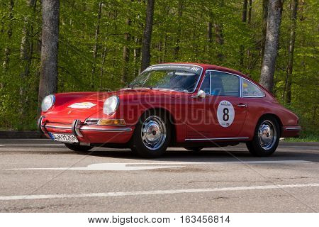 HEIDENHEIM GERMANY - MAY 4 2013: Hans Bruckmann and Gabriele Bruckmann in their 1965 Porsche 912 at the ADAC Wurttemberg Historic Rallye 2013 on May 4 2013 in Heidenheim Germany.