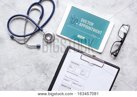 concept of appointment to doctor online top view.