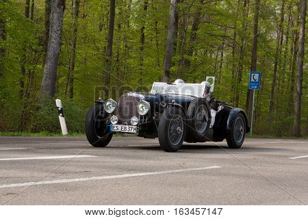 HEIDENHEIM GERMANY - MAY 4 2013: Eberhard Blumenstock and Birgit Blumenstock in their 1938 Alvis Speed 25 at the ADAC Wurttemberg Historic Rallye 2013 on May 4 2013 in Heidenheim Germany.