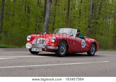HEIDENHEIM GERMANY - MAY 4 2013: Armin Labor and Nicolai Kroger in their 1958 MG A at the ADAC Wurttemberg Historic Rallye 2013 on May 4 2013 in Heidenheim Germany.