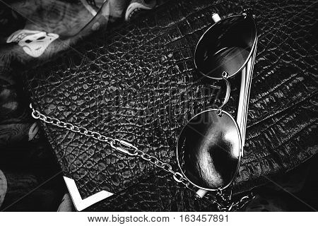 Ladies Fashion Accessories. Clutch and Sunglasses in blackly white