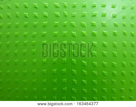 background texture of a gymnastic ball green color close up