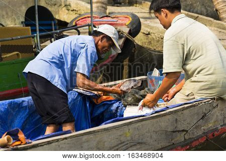 My Tho, Vietnam - February 14: Fisherman Sells Fish On Boat On February 14, 2012 In My Tho, Vietnam.