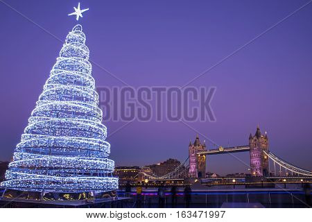 LONDON, UK - DECEMBER 29TH 2016: A view of the magnificent Tower Bridge with an illuminated Christmas Tree in London, on 29th December 2016.
