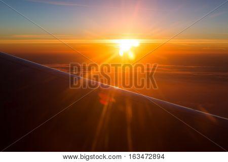 Amazing view from plane. Morning sunrise background.