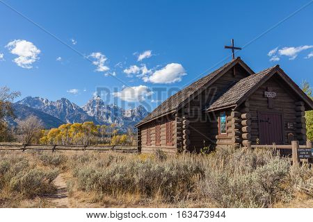 the historic chapel of the transfiguration in teton national park in fall