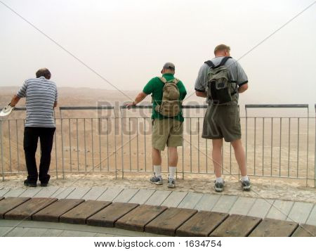 Tourists Looking At Mountains Of Sand In Massada/Israel
