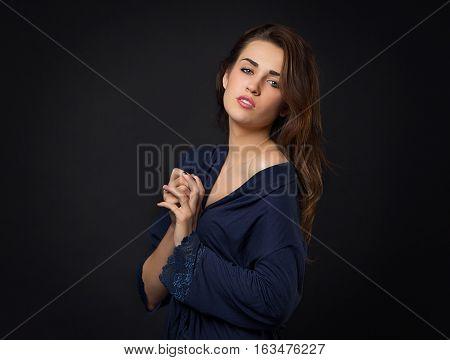Girl In Blue Peignoir With Bare Shoulder. Dark Background.