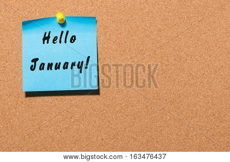Hello January - business concept with text - written on sticker pinned at notice board, Empty space.