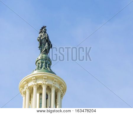 close up of statue on top of Capitol Building Washington DC
