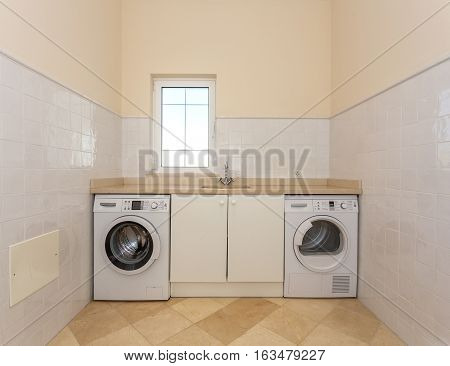 Inside the home laundry. For residents of the building.