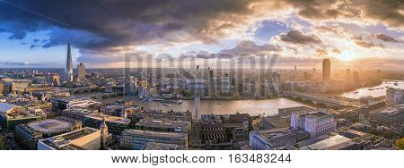 London England - Panoramic skyline view of south London at sunset with famous skyscrapers and dark clouds over the city
