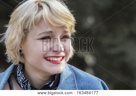 Beautiful alternative styled girl laughing portrait in the street