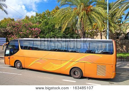 Orange tourist bus in Barcelona, Catalonia, Spain