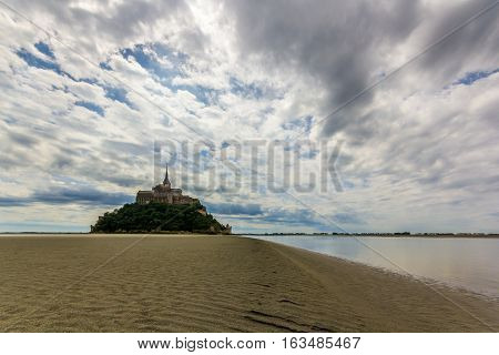 French catherdral on a island in a sandy bay