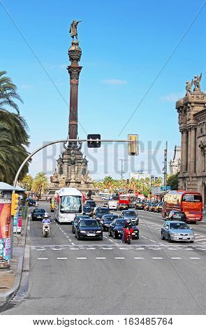 BARCELONA, SPAIN - OCTOBER 08, 2013: Traffic near Columbus monument in Barcelona, Spain. Columbus Monument is 60 m. It is located at finish La Rambla and built in 1888
