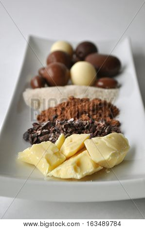 Ingredients for making chocolate on a white plate