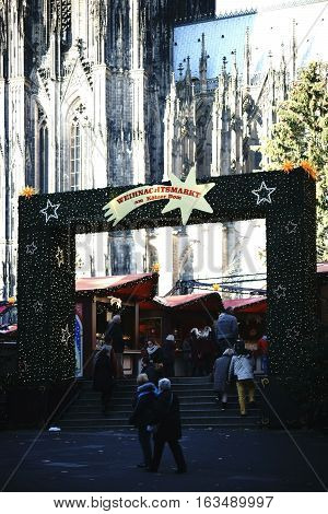 COLOGNE, GERMANY - NOVEMBER 24: The entrance gateway to the Christmas market at Cologne Cathedral decorated with Christmas lights on November 24, 2016 in Cologne.