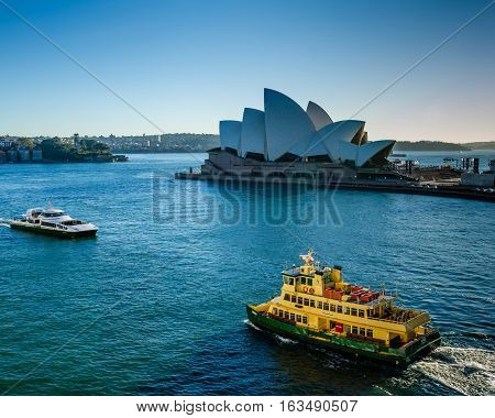 SIDNEY - AUSTRALIA NOVEMBER 2, 2016: Passenger ferries sail past the Sidney Opera House, a multi-venue performing arts center, designed by Danish architect Jorn Utzon.