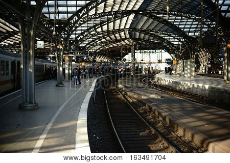 COLOGNE, GERMANY - NOVEMBER 24: Travelers standing on a railway track of the Cologne main railway station under a glass canopy on November 24, 2016 in Cologne.