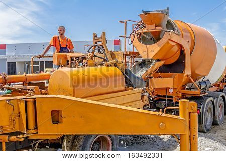 Zrenjanin Vojvodina Serbia - July 28 2015: Truck mixer is pouring concrete into concrete pump for casting.