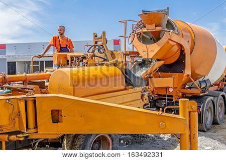 Zrenjanin Vojvodina Serbia - July 28 2015: Truck mixer is pouring concrete into concrete pump for casting.
