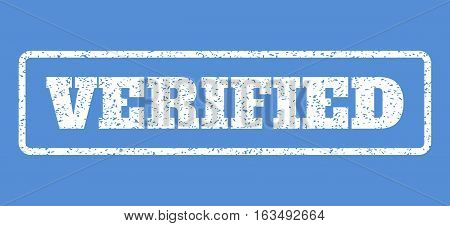 White rubber seal stamp with Verified text. Vector message inside rounded rectangular frame. Grunge design and dirty texture for watermark labels. Horisontal sticker on a blue background.