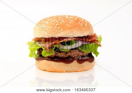 Fresh delicious burger whith bacon and salad isolated