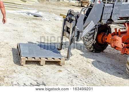 Logistics concept close up view on telescopic forklift at construction site