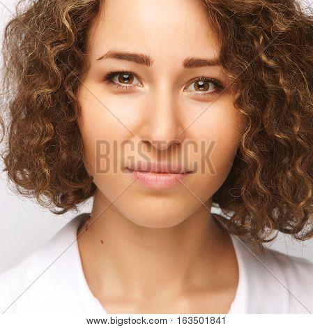 Portrait of dissatisfied young woman, studio portrait