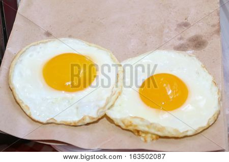 Double chicken fried eggs like an eyes