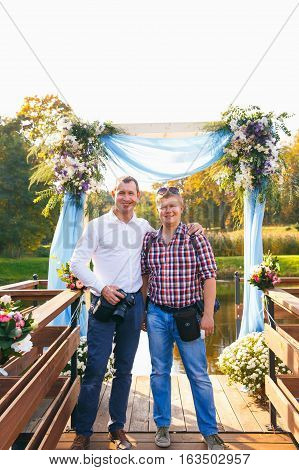 GRODNO BELARUS - OCT 02: Two photographers on wedding ceremony posing during workshop in manor-Park complex on October 02 2016 in Radzivilki Belarus