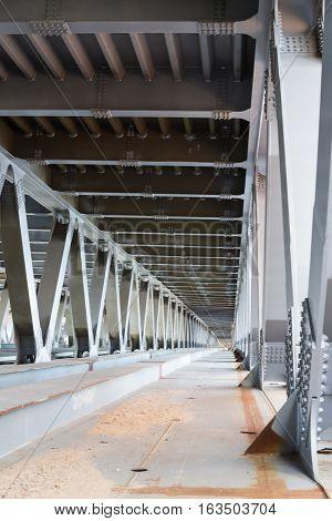 Bridge construction. Metal framework of the bridge