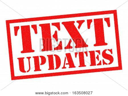 TEXT UPDATES red Rubber Stamp over a white background.