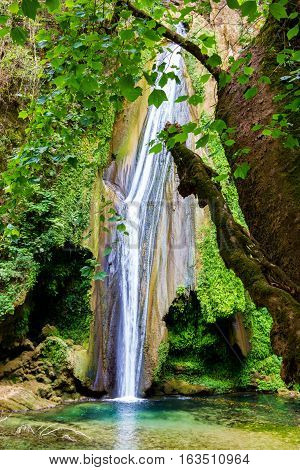 Aquamarine Waterfall Sierra Gorda Mexico. El Chuveje is one of the largest waterfalls in Queretaro. It's thirty meters high and surrounded by mountains, vegetation and a stunning landscape.