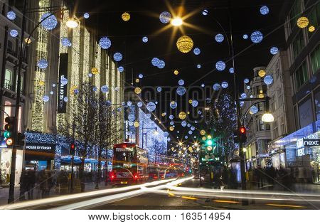 LONDON UK - DECEMBER 9TH 2015: A view of a busy Oxford Street in the lead up to Christmas in London on 9th December 2015.
