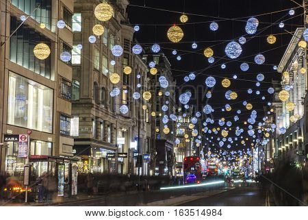 LONDON UK - DECEMBER 9TH 2015: A view of a bustling Oxford Street during the lead up to Christmas in London on 9th December 2015.
