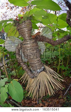 Fairy made from vines and palm fronds to decorate garden
