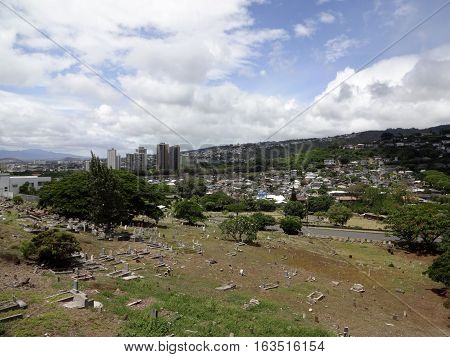 Yee King Tong Cemetery and Uluhaimalama cemetery on hillside. Uluhaimalama is now set in an urban neighborhood composed of medium to high density single family and multi-unit housing. The cemetery is located on the lots that once served as the Royal Flowe