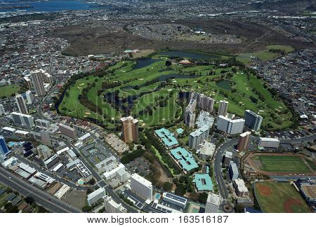 Aerial of Honolulu Country Club in Salt Lake community and Pearl Harbor in the distance on Oahu Hawaii.