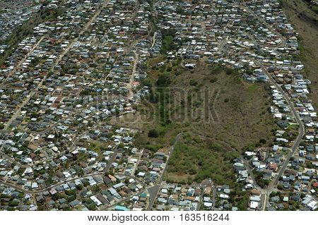 Aerial of Mau'Umae Nature Park and Surrounding Neighborhood of Palolo Valley on Oahu Hawaii. April 2016.