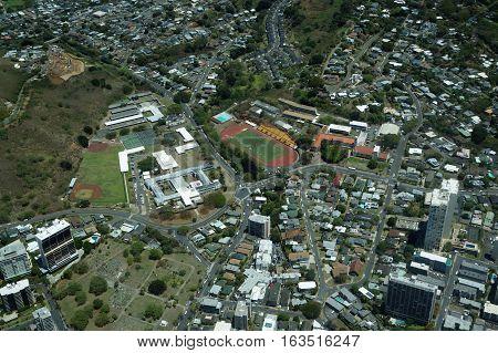 Aerial view of Roosevelt High School Stevenson Intermediate School Makiki Cemetery and surrounding neighborhood in Makiki on Oahu Hawaii