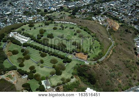 Aerial view of Punchbowl Cemetery or the National Memorial Cemetery of the Pacific with parts under construction which is visited by millions of tourist and island locals every year on the tropical island of Oahu in Honolulu Hawaii USA.