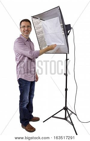 Photographer with Studio Lighting Equipment for Photography