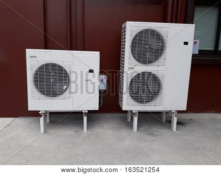 Big two air-conditioner compressor on the floor