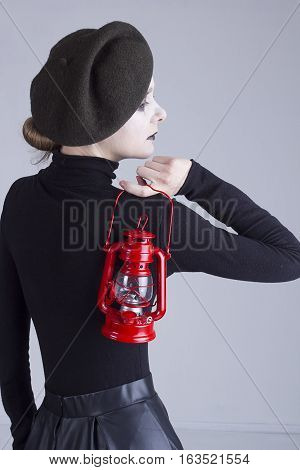 Young beautiful woman mime with red lantern