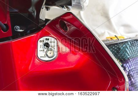 Focused At  Motorbike Key Hole Or On Off Menu ,red Motorcycle