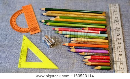 Wooden pencil sharpener and a ruler and a protractor