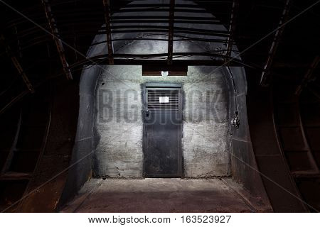 Underground tunnel. Mysterious iron door. Secret entrance.