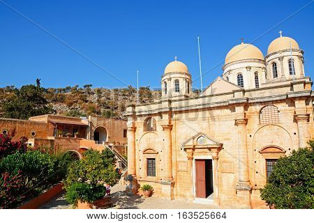 AGIA TRIADA, CRETE - SEPTEMBER 16, 2016 - Elevated view of the front of the Agia Triada monastery and domes with courtyard buildings to the left Agia Triada Crete Greece Europe, September 16, 2016.